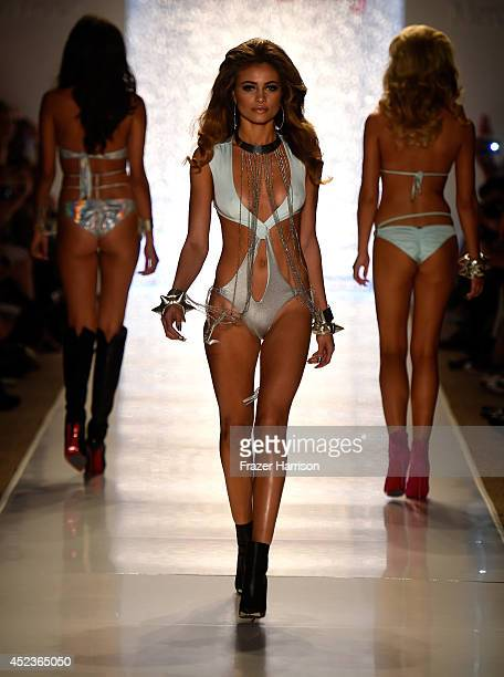 A model walks the runway at the Beach Bunny Featuring The Blonds show during MercedesBenz Fashion Week Swim 2015 at Cabana Grande at The Raleigh on...