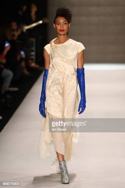 A model walks the runway at the Belma Ozdemir show during Mercedes Benz Fashion Week Istanbul at Zorlu Performance Hall on March 28 2018 in Istanbul...