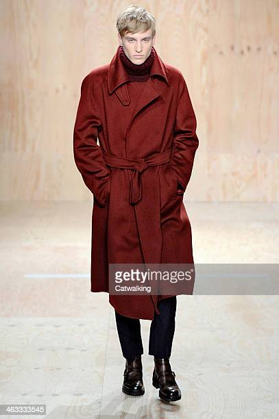 A model walks the runway at the Berluti Autumn Winter 2014 fashion show during Paris Menswear Fashion Week on January 17 2014 in Paris France