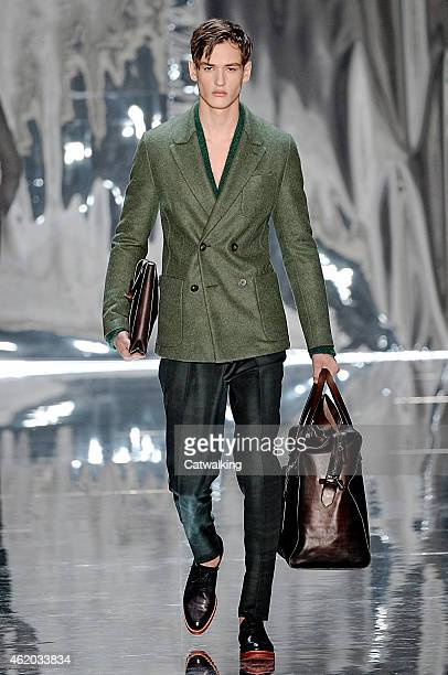 A model walks the runway at the Berluti Autumn Winter 2015 fashion show during Paris Menswear Fashion Week on January 23 2015 in Paris France