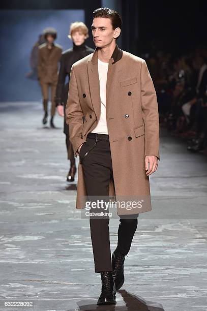A model walks the runway at the Berluti Autumn Winter 2017 fashion show during Paris Menswear Fashion Week on January 20 2017 in Paris France