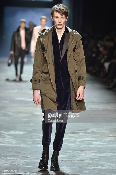 A model walks the runway at the Berluti Autumn Winter 2017 fashion show during Paris Menswear Fashion Week on January 20 2017 in Paris France