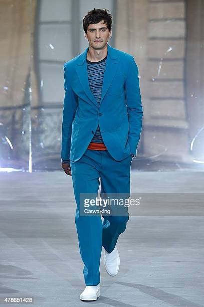 A model walks the runway at the Berluti Spring Summer 2016 fashion show during Paris Menswear Fashion Week on June 26 2015 in Paris France