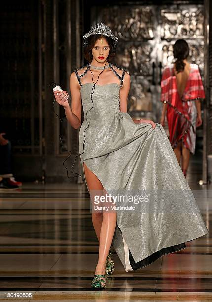 A model walks the runway at the Bernard Chandran show at the Fashion Scout venue during London Fashion Week SS14 at Freemasons Hall on September 13...