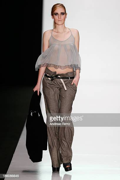 A model walks the runway at the Best Collections of BHSAD Fashion Design Course show during MercedesBenz Fashion Week Russia S/S 2014 on October 28...