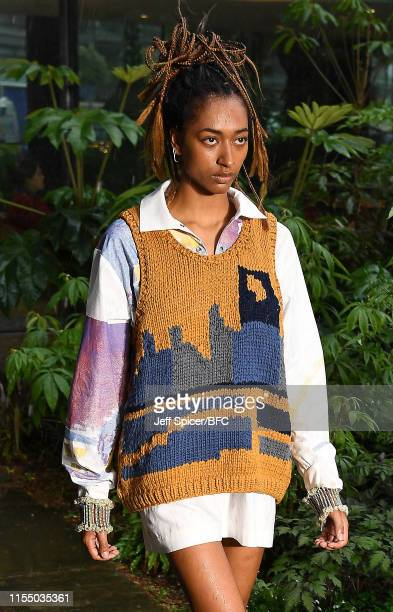 A model walks the runway at the Bethany Williams presentation during London Fashion Week Men's June 2019 at The Garden Museum on June 10 2019 in...