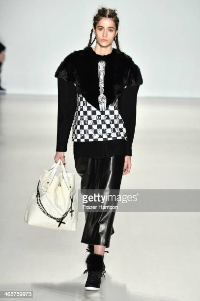 A model walks the runway at the BIG PARK fashion show during MercedesBenz Fashion Week Fall 2014 at The Salon at Lincoln Center on February 11 2014...