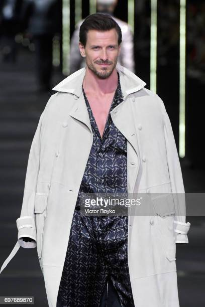 A model walks the runway at the Billionaire show during Milan Men's Fashion Week Spring/Summer 2018 on June 19 2017 in Milan Italy