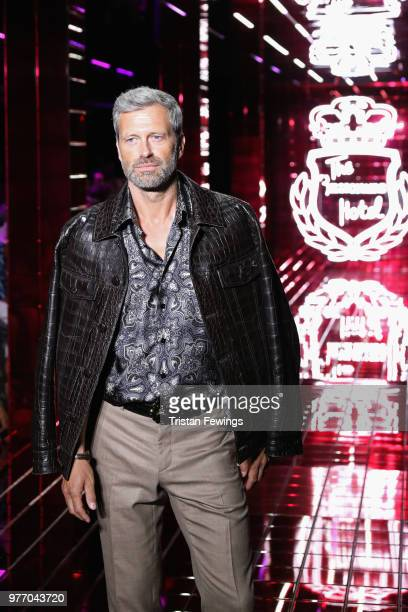 A model walks the runway at the Billionaire show during Milan Men's Fashion Week Spring/Summer 2019 on June 17 2018 in Milan Italy
