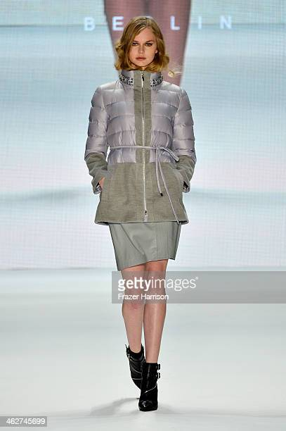 A model walks the runway at the Blacky Dress Berlin show during MercedesBenz Fashion Week Autumn/Winter 2014/15 at Brandenburg Gate on January 15...
