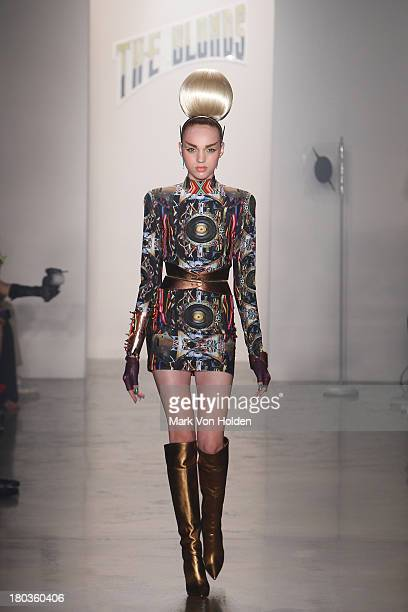 A model walks the runway at The Blonds fashion show during MADE Fashion Week Spring 2014 at Milk Studios on September 11 2013 in New York City