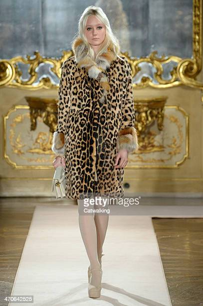A model walks the runway at the Blugirl Autumn Winter 2014 fashion show during Milan Fashion Week on February 20 2014 in Milan Italy
