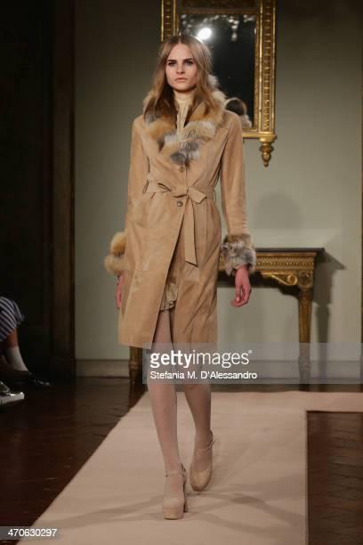 Model walks the runway at the Blugirl Show during Milan Fashion Week Womenswear Autumn/Winter 2014 on February 20, 2014 in Milan, Italy.