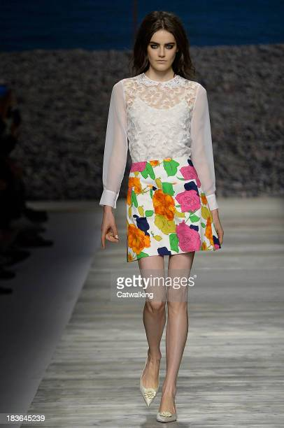 A model walks the runway at the Blugirl Spring Summer 2014 fashion show during Milan Fashion Week on September 19 2013 in Milan Italy