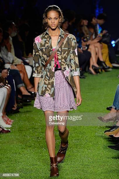 Model walks the runway at the Blugirl Spring Summer 2015 fashion show during Milan Fashion Week on September 18, 2014 in Milan, Italy.