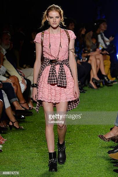 A model walks the runway at the Blugirl Spring Summer 2015 fashion show during Milan Fashion Week on September 18 2014 in Milan Italy