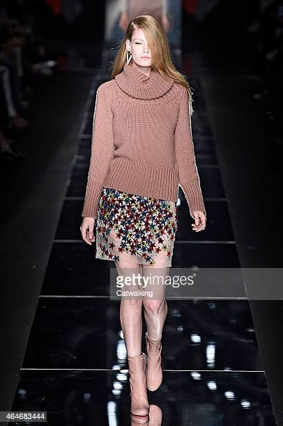 A model walks the runway at the Blumarine Autumn Winter 2015 fashion show during Milan Fashion Week on February 27 2015 in Milan Italy