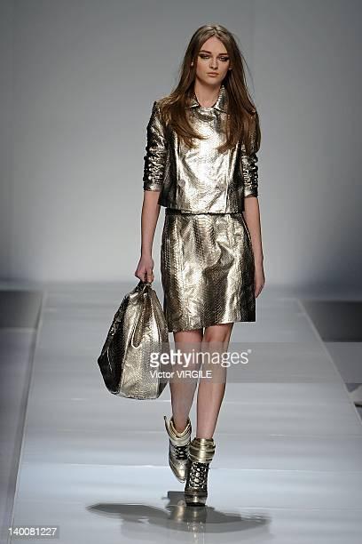 Model walks the runway at the Blumarine Autumn/Winter 2012/2013 fashion show as part of Milan Womenswear Fashion Week on February 24, 2012 in Milan,...