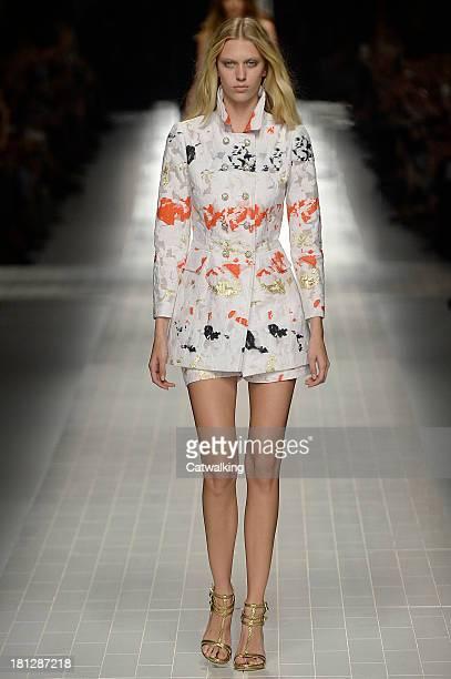 A model walks the runway at the Blumarine Spring Summer 2014 fashion show during Milan Fashion Week on September 20 2013 in Milan Italy