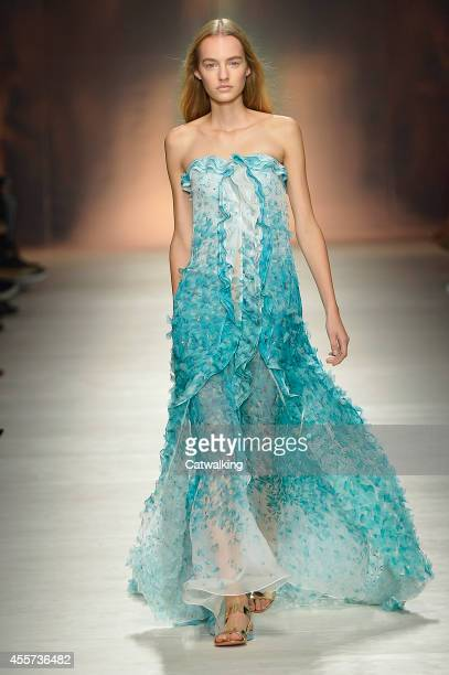 A model walks the runway at the Blumarine Spring Summer 2015 fashion show during Milan Fashion Week on September 19 2014 in Milan Italy