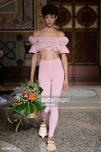 A model walks the runway at the Blumarine Spring Summer 2017 fashion show during Milan Fashion Week on September 24 2016 in Milan Italy