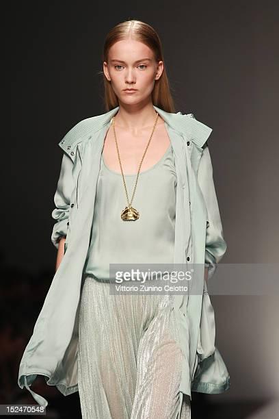 Model walks the runway at the Blumarine Spring/Summer 2013 fashion show as part of Milan Womenswear Fashion Week on September 21, 2012 in Milan,...