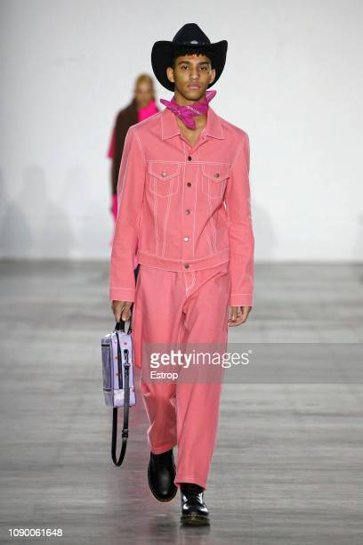 A model walks the runway at the Bobby Abley show during London Fashion Week Men's January 2019 at the BFC Show Space on January 5 2019 in London...