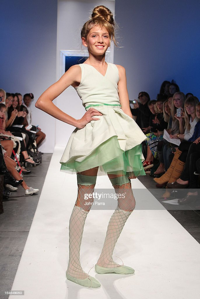 A model walks the runway at the Bonnie Young show during Petite Parade NY Kids Fashion Week In Collaboration With VOGUEbambini - Day 2 at Industria Superstudio on October 21, 2012 in New York City.