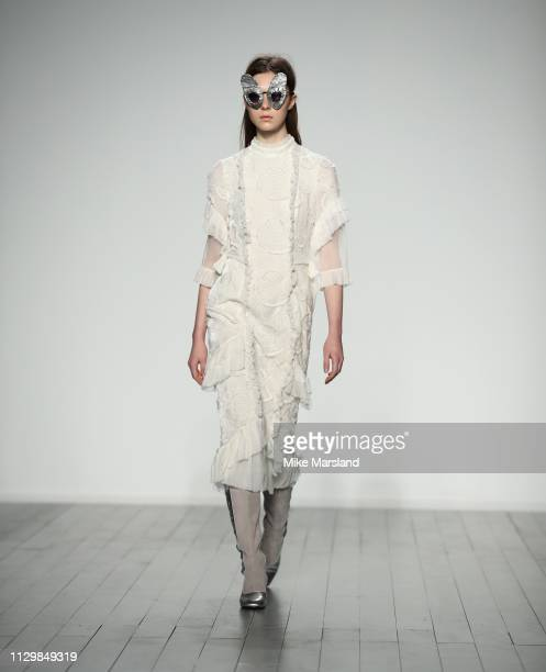 A model walks the runway at the Bora Aksu show during London Fashion Week February 2019 at the BFC Show Space on February 15 2019 in London England