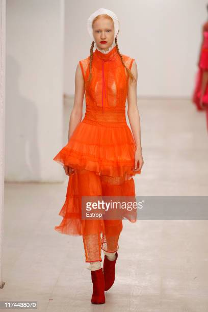 Model walks the runway at the BORA AKSU show during London Fashion Week September 2019 at the BFC Show Space on September 13, 2019 in London, England.