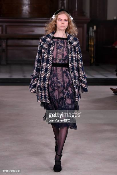Model walks the runway at the Bora Aksu show during London Fashion Week February 2020 on February 17, 2020 in London, England.