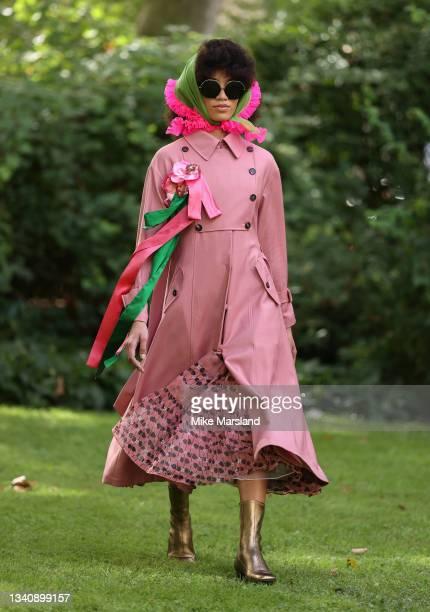 Model walks the runway at the Bora Aksu show during London Fashion Week September 2021 on September 17, 2021 in London, England.