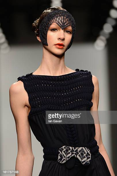 Model walks the runway at the Bora Aksu show during London Fashion Week Fall/Winter 2013/14 at Somerset House on February 15, 2013 in London, England.