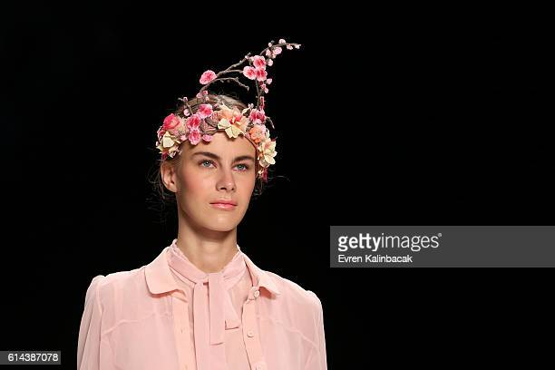 Model walks the runway at the Bora Aksu show during Mercedes-Benz Fashion Week Istanbul at Zorlu Center on October 13, 2016 in Istanbul, Turkey.