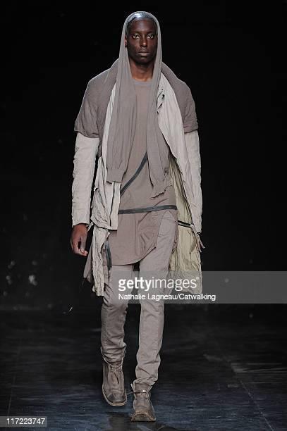 A model walks the runway at the Boris Bidjan Saberi menswear fashion show during Paris Fashion Menswear Week on June 24 2011 in Paris France