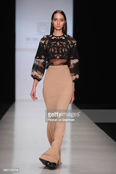 A model walks the runway at the Borodulins show during MercedesBenz Fashion Week Russia Fall/Winter 2013/2014 at Manege on March 31 2013 in Moscow...
