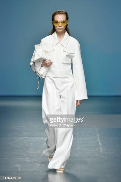 A model walks the runway at the Boss show during the Milan Fashion Week Spring/Summer 2020 on September 22 2019 in Milan Italy