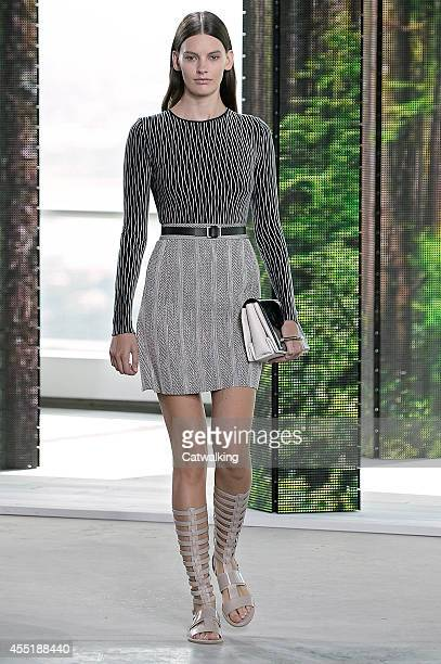 A model walks the runway at the Boss Spring Summer 2015 fashion show during New York Fashion Week on September 10 2014 in New York United States