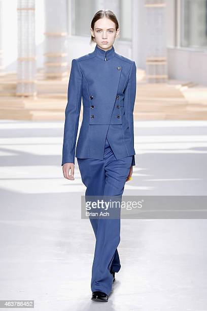 Model walks the runway at the Boss Womens fashion show during Mercedes-Benz Fashion Week Fall on February 18, 2015 in New York City.