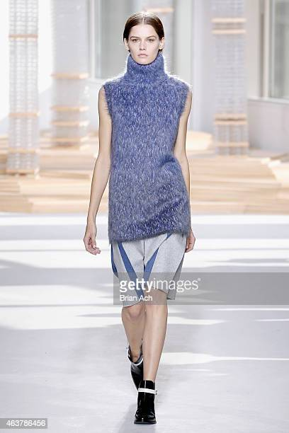 A model walks the runway at the Boss Womens fashion show during MercedesBenz Fashion Week Fall on February 18 2015 in New York City