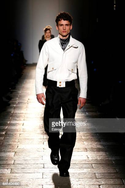 A model walks the runway at the Bottega Veneta designed by Thomas Maier show during Milan Fashion Week Fall/Winter 2017/18 on February 25 2017 in...