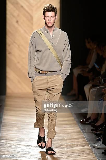 A model walks the runway at the Bottega Veneta Spring Summer 2015 fashion show during Milan Menswear Fashion Week on June 21 2015 in Milan Italy