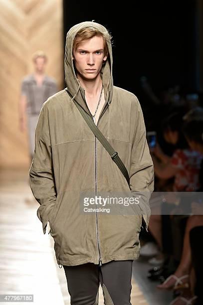 Model walks the runway at the Bottega Veneta Spring Summer 2015 fashion show during Milan Menswear Fashion Week on June 21, 2015 in Milan, Italy.