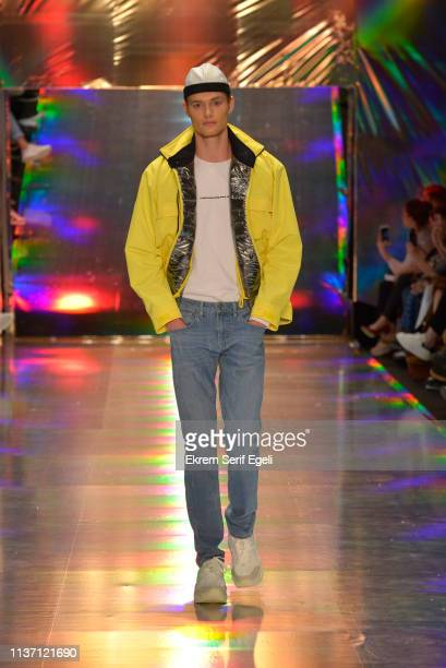 A model walks the runway at the Brand Who show during MercedesBenz Istanbul Fashion Week at the Zorlu Performance Hall on March 20 2019 in Istanbul...