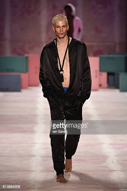 A model walks the runway at the Brand Who show during MercedesBenz Fashion Week Istanbul at Zorlu Center on October 14 2016 in Istanbul Turkey
