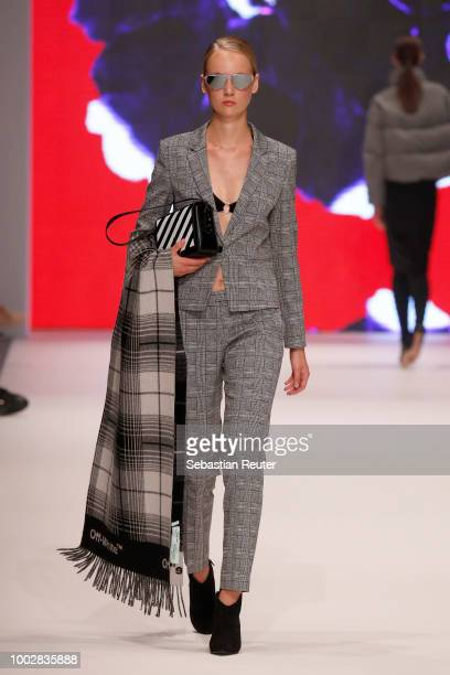 A model walks the runway at the Breuninger show during Platform Fashion July 2018 at Areal Boehler on July 20 2018 in Duesseldorf Germany