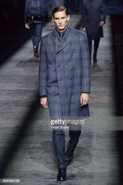 A model walks the runway at the Brioni show during Milan Men's Fashion Week Fall/Winter 2016/17 on January 18 2016 in Milan Italy