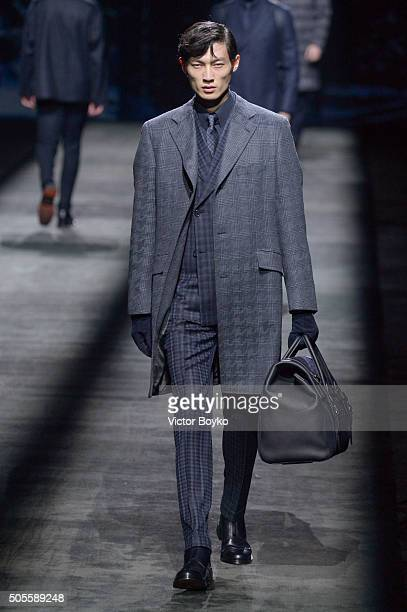 Model walks the runway at the Brioni show during Milan Men's Fashion Week Fall/Winter 2016/17 on January 18, 2016 in Milan, Italy.