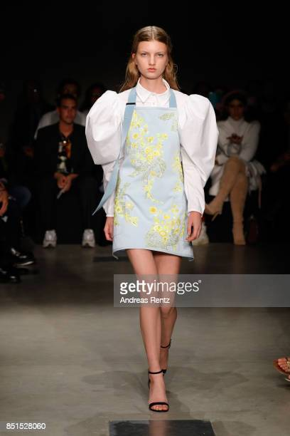 A model walks the runway at the Brognano show during Milan Fashion Week Spring/Summer 2018 on September 22 2017 in Milan Italy