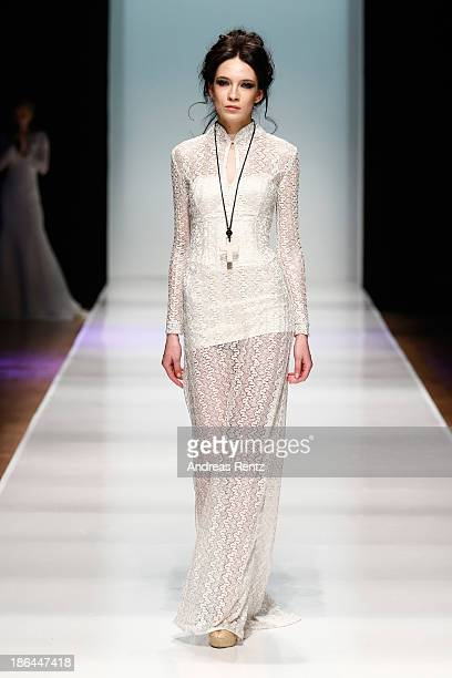 A model walks the runway at the Bunker Z show during MercedesBenz Fashion Week Russia S/S 2014 on October 31 2013 in Moscow Russia